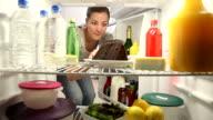 Woman sneaks bite of chocolate cake video