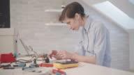 4K: Woman Soldering A Circuit Board In Her Office. video