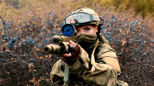 A woman soldier with a weapon video