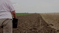 TS Woman Sowing On A Field video