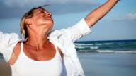 Woman spinning on beach video