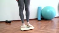 Woman Standing on Weight Scale and Being Happy video