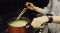 Woman Stirring Noodles video