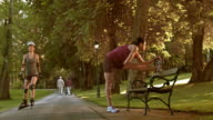 DS Woman stretching on a park bench video