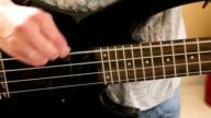 Woman Strumming An Electric Bass Guitar video