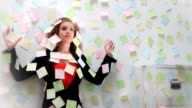 Woman stuck to wall with notes video