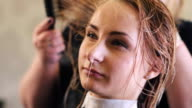 Woman, Stylist, Hairdresser Dries The Model's Hairs with White Dryer, Making The Hairstyle For a Woman with Long Hairs Close Up, hairdresser's hands close up, Barbershop, Hairdressing Salon, Beauty. video