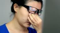 Woman suffering from eye strain video