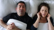 Woman suffers from her partner snoring in bed video