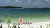 HD: Woman Sunbathing On The Beach video