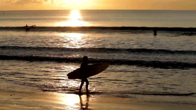 Woman surfer on beach video