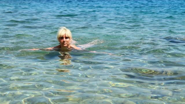 HD: Woman Swimming In The Sea video