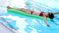 woman swimming on an air mattress video