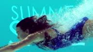 Woman swimming underwater video