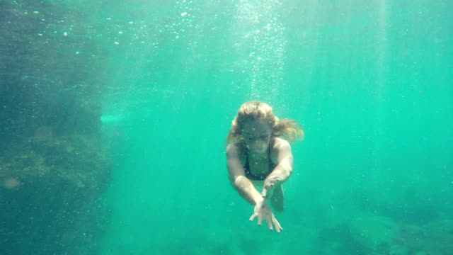 Woman Swimming Underwater. Young Attractive Beautiful Woman Mermaid. video