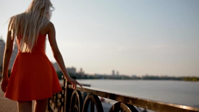 Woman take a rest on embankment video