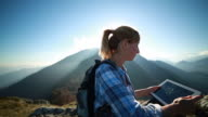 Woman takes picture from mountain peek video