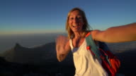 Woman takes selfie portrait on top of Table Mountain, Cape Town video