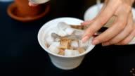 Woman takes sugar from the sugar tongs video