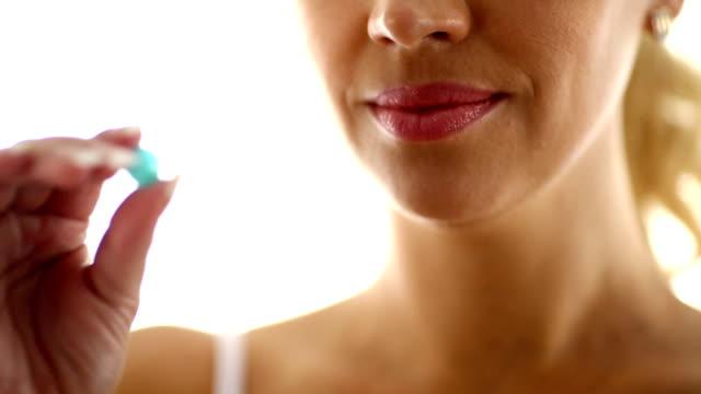 Woman taking a pill. video