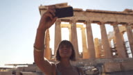 Woman taking a selfie in front of Parthenon video