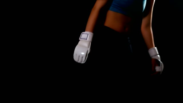 Woman taking breath tired exhausted disappointed after boxing kicking, black background video