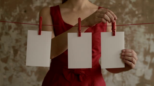 Woman taking cards off the pegs video