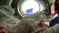 POV Woman Taking Laundry Out Of Washing Machine video