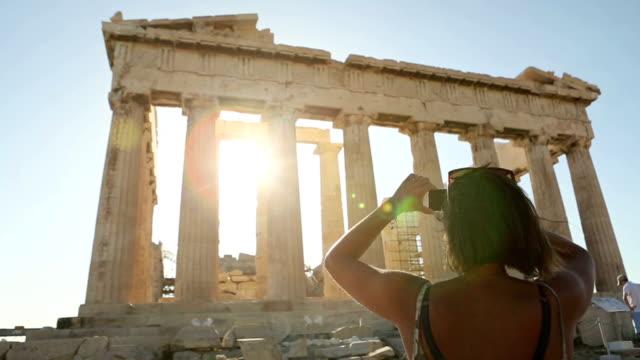 Woman taking picture to Parthenon video