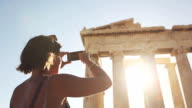 Woman taking picture to Parthenon video