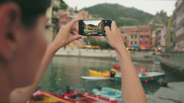Woman taking pictures in Vernazza - Cinque Terre village. video