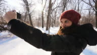 Woman taking pictures in winter time. video