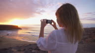 Woman Taking Pictures With Phone video