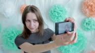 Woman taking selfie at photographic studio video