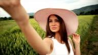 Woman taking selfie. Slow motion video