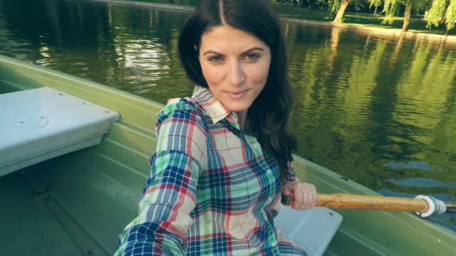 Woman taking selfies while rowing. video