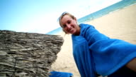 Woman talking a selfie by the beach video
