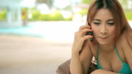 Woman talking by phone video