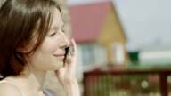 woman talking on a phone video