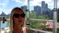 Woman talking on camera in a gondola on a ferris wheel video