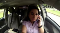 Woman talking on mobile phone in the car driving. video