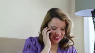 Woman talking on mobile phone video