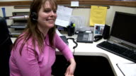 Woman talking on telephone headset video