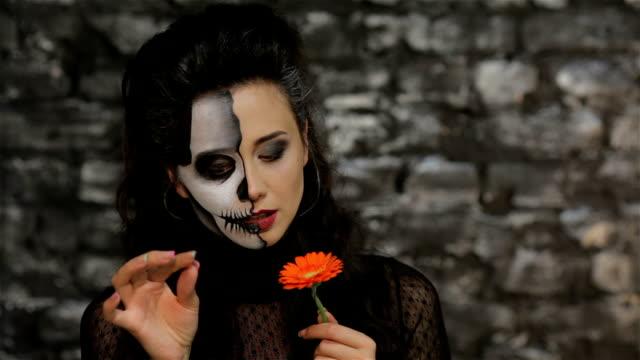 A woman tells fortunes tearing petals video
