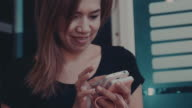 Woman texting and reading a text message video