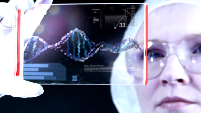 Woman the scientist is analysing structure DNA. video