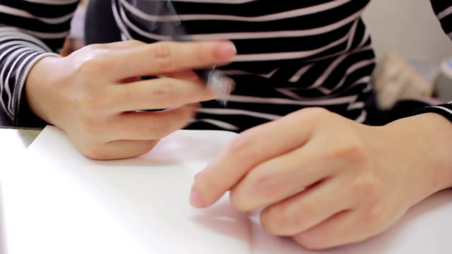 Woman thinking and playing pen while writing on notebook video