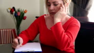 Woman thinking and writing video
