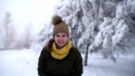 Woman throwing a snowball into the camera video