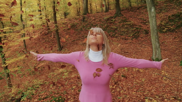 HD SLOW MOTION: Woman Throwing Leaves In The Air video